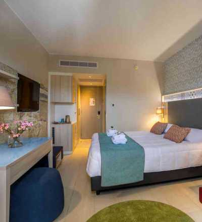 Elegant twin/double room at Leonardo Laura Beach & Splash Resort with inland view and SPA amenities